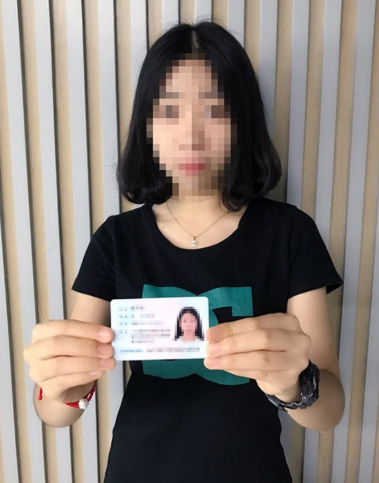 A picture of the person responsible for the website with their identity card in their hand